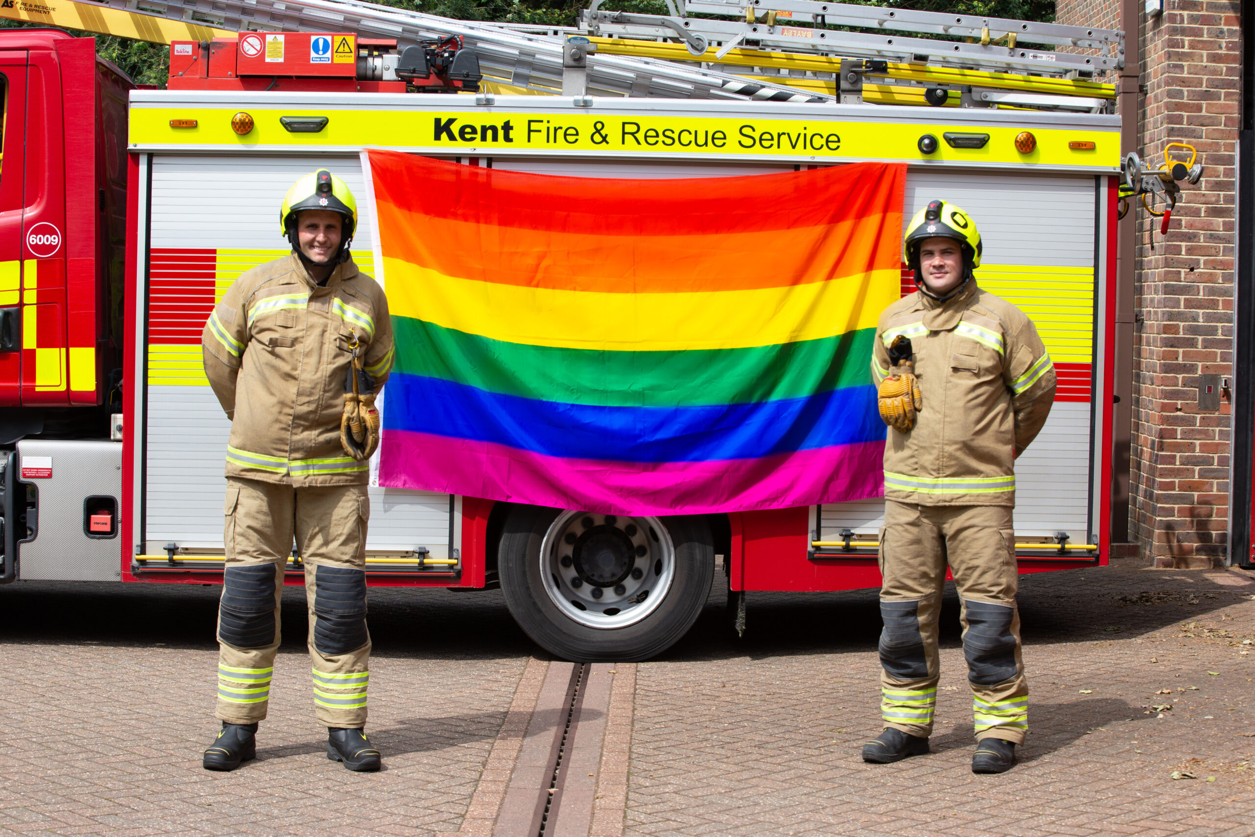 Firemen with LGBT Flag